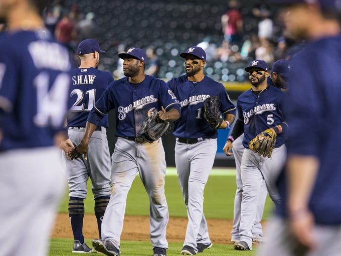 Brewers players celebrate after defeating the Diamondbacks