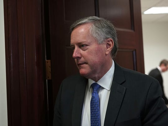 Rep. Mark Meadows, R-N.C., leaves after the weekly