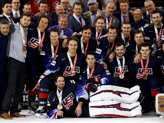 The United States team celebrates winning the bronze medal after defeating Canada, 4-1, in the World Championship at Royal Arena on Saturday, May 20, 2018 in Copenhagen, Denmark.