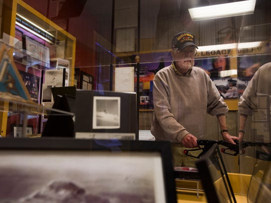 World War II Navy Seabees veteran Norm Oliphant looks through displays on May 5, 2018, at the National Museum of World War II Aviation in Colorado Springs, Colorado.