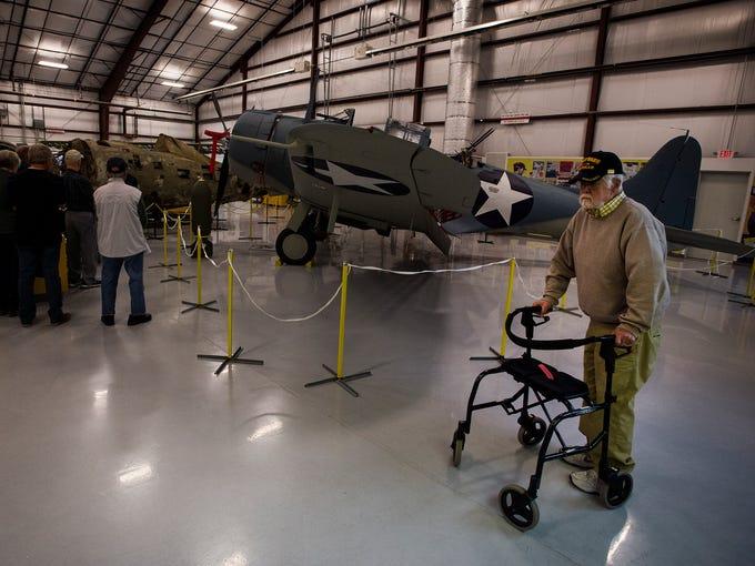 World War II Navy Seabees veteran Norm Oliphant walks