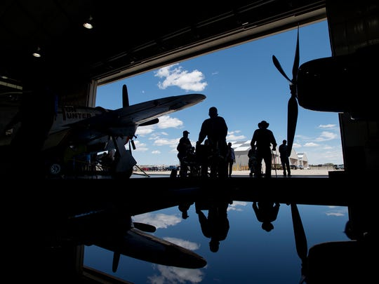 World War II Army Air Corp veterans walk through a hangar housing restored aircrafts on May 5, 2018, at the National Museum of World War II Aviation in Colorado Springs, Colorado.