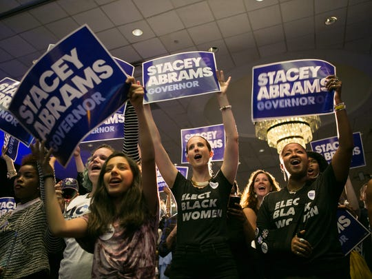 Supporters of Georgia Democratic Gubernatorial candidate Stacey Abrams cheer during a primary election night event on May 22, 2018 in Atlanta, Georgia.  If elected, Abrams would become the first African American female governor in the nation.