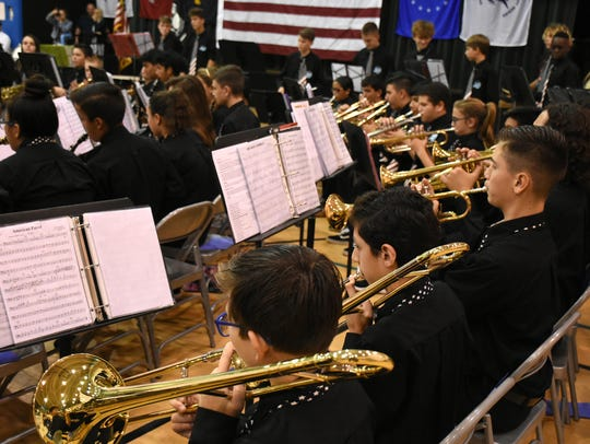 File:  Part of the trombone section plays during a previous salute to veterans at Marco Island Charter Middle School Band.