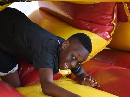 File; MICMS student Roy Obsaint squirts out of the inflatable obstacle course. The Marco Island Parks and Recreation Department sponsors the traditional end-of-the-school year teen bash.