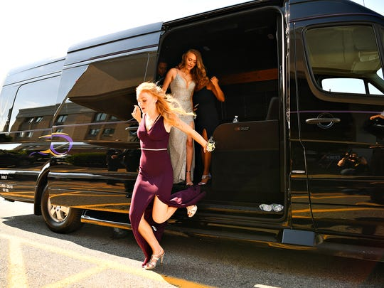 Students and their guests arrive at Red Lion Hotel Harrisburg for the Northern York High School Prom in Harrisburg, Saturday, May 26, 2018. Dawn J. Sagert photo