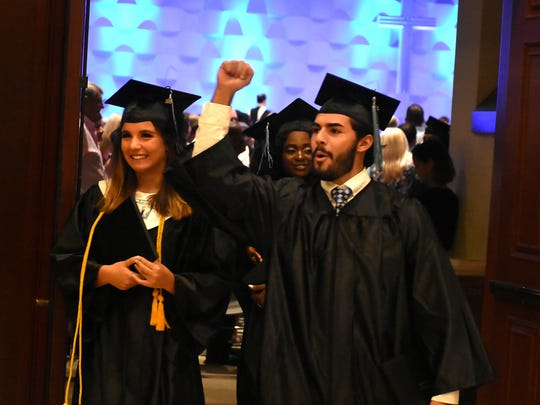 Graduates exult after their recessional. Marco Island Academy graduated its 2018 senior class Friday evening in a ceremony at the Family Church.