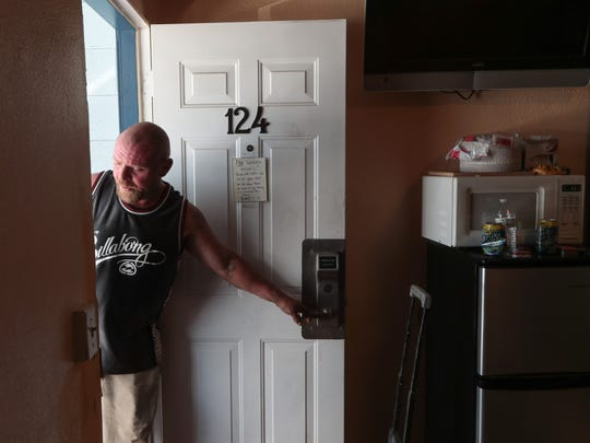 Bryan Hensley leaves the room he was sharing with his girlfriend at City Center Motel in Indio, Calif., Tuesday, May 29, 2018.  Hensley and nearly 40 others were housed at the hotel after being evicted from land in Coachella a month ago.