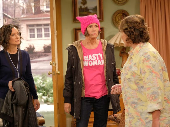 "The revived ""Roseanne"" dealt with real-world issues, such as families divided over President Trump, as seen here in this confrontation between sisters Jackie (Laurie Metcalf), center, and Roseanne (Roseanne Barr), right."