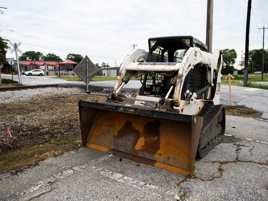 Construction equipment sits where road work is currently beginning in downtown Greer on Friday, June 1, 2018.