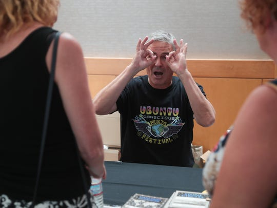 Author Michael Tellinger signs books at Contact in the Desert in Indian Wells, Calif., Sunday, June 3, 2018.