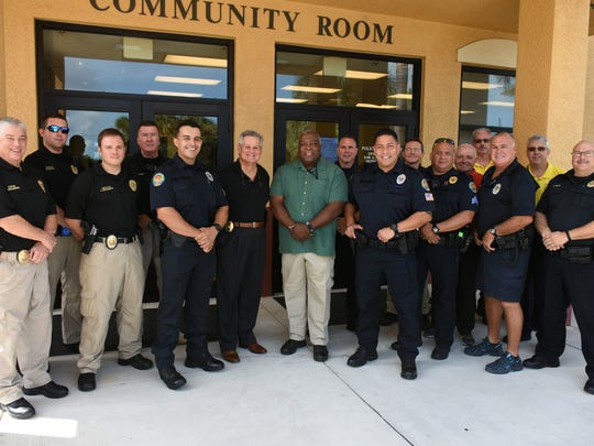 Marco Island police officers pose outside of the police department's building last year.
