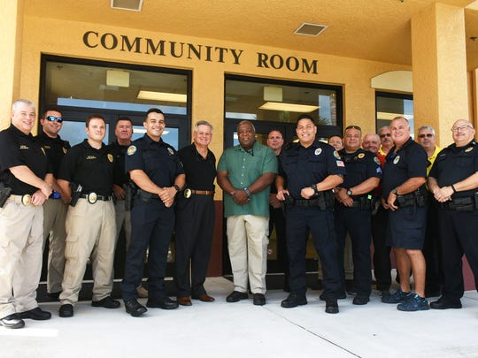 New MIPD officers Juan Monsalve, Dwayne Johnson, and Allan Reyes with Chief Al Schettino in the center of a group of MIPD officers. The Marco Island Police Department is bringing on seven new fulltime officers, plus additional reserve and community service officers.