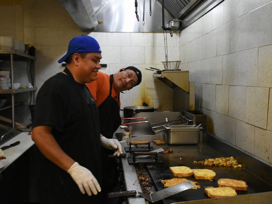 Chef Arnie Hernandez, left, and Rufino Arteaga clown