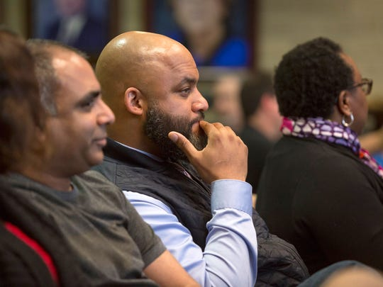 Detroit Police detective and Rochester Hills resident Khary Mason, center, attends a Rochester Hills City Council meeting on Monday, April 23, 2018, in Rochester Hills.