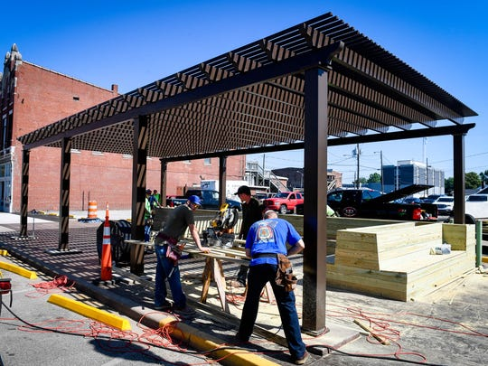 "Volunteers with the Tri-County Council of Labor build furniture for the new ""The Perch"" pocket park under construction on Second Street in Henderson Wednesday, June 6, 2018."