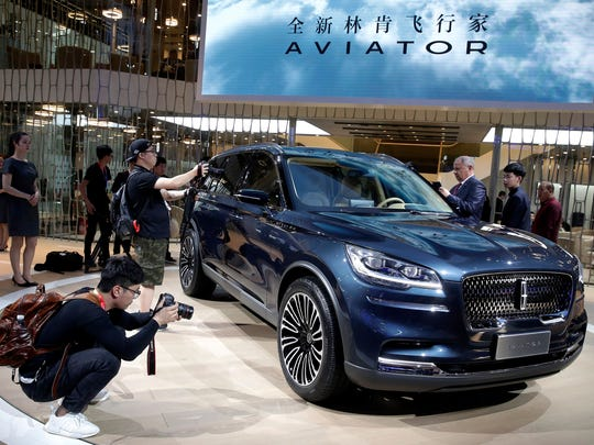 Journalists film the Lincoln Aviator SUV after the reveals at the China Auto Show in Beijing in April 2018.