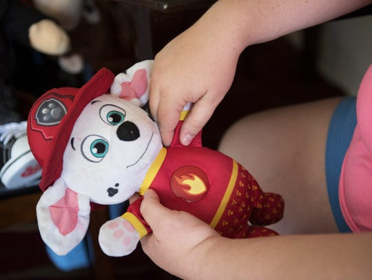 Krista Nix holds a toy of her 18-month-old son, Jojo,