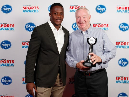 Teddy Bridgewater poses with Gil Downs, representing