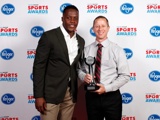 Teddy Bridgewater poses with coach Nate Fulgham, accepting the Competitive Cheer Team of the Year award for Bullitt East, during the 2018 Courier Journal Sports Awards held at The Louisville Palace in downtown Louisville. June 7, 2018
