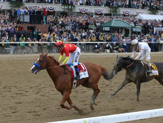 Mike Smith aboard Justify pulls away from Jose Ortiz