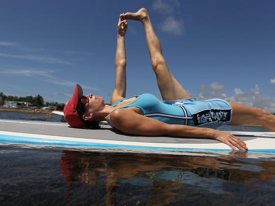 Erin Yanowitch enjoys a paddleboard yoga session at Adventure Sports Miami on July 10, 2011.
