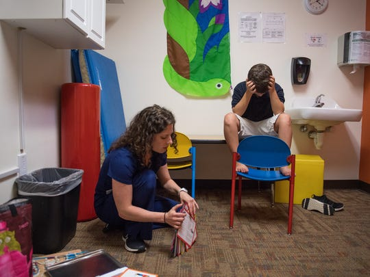 Kelly MacIntire works with Sam Blackwood, 9, during an occupational therapy appointment at Kidnetics in Greenville on Tuesday, June 19, 2018.