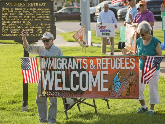 Rev. Jim Flynn, left, protesting U.S. immigration practices, at Shelbyville Rd and S. Hurstbourne Pkwy in Louisville, KY. June 14, 2018