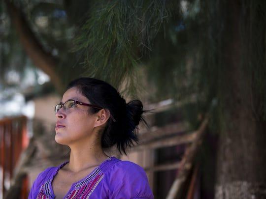 Areli Aguilar, 32, of Honduras, talks during an interview