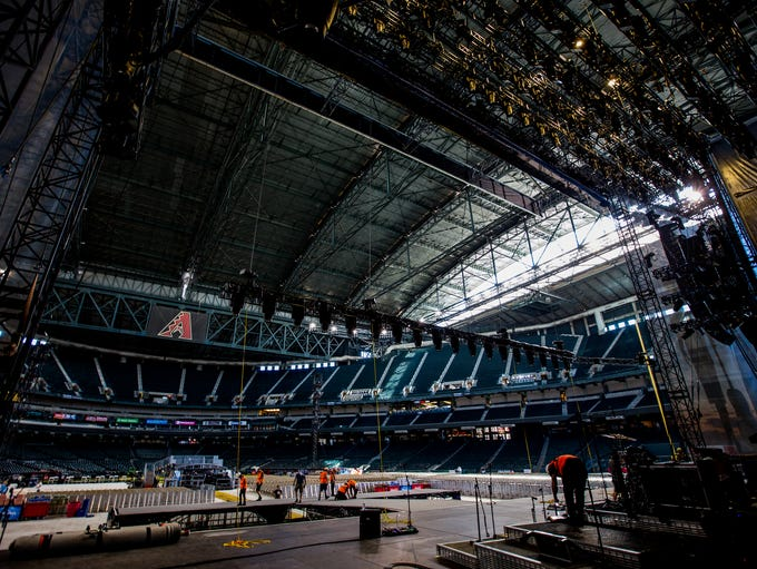 Crews set up for Kenny Chesney's Trip Around the Sun
