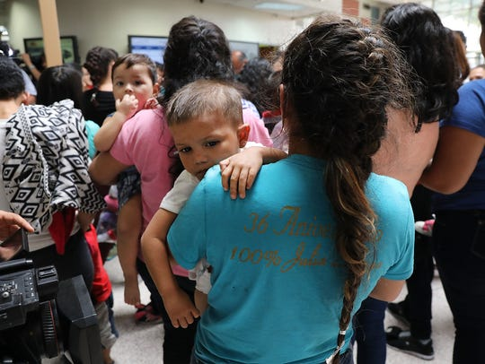 Dozens of women and their children, many fleeing poverty
