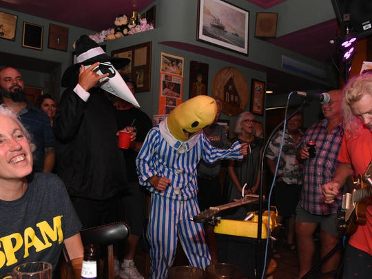 Revelers get down to the sounds of Michael Bell and the Raiford Starke Band. Spammy Jammy, the Goodland party meant to ward off hurricanes.