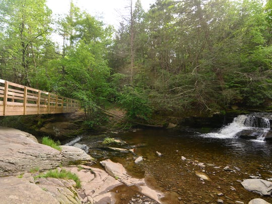 A small bridge crosses the falls.