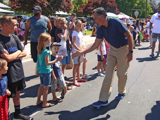 Mitt Romney greets children in the Strawberry Day Parade in Pleasant Grove on Saturday, part of his last-minute campaign push.