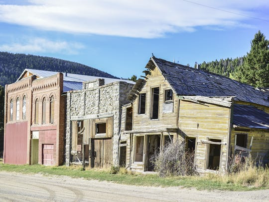 These three buildings are located at the entrance of Marysville, Mont. This once booming gold mining town was built and established around  in 1876.