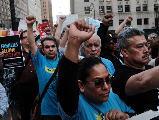 Hundreds of immigrant rights advocates rally at the