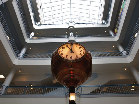 The original clock that hung in the Sibley's department store is now mounted in the renovated space.