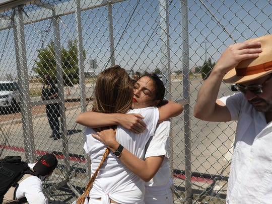 Alexandria Ocasio-Cortez is embraced at the Tornillo-Guadalupe
