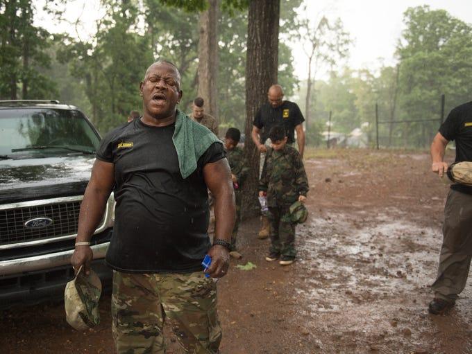 Drill Sergeant Steven Sullivan says a prayer after