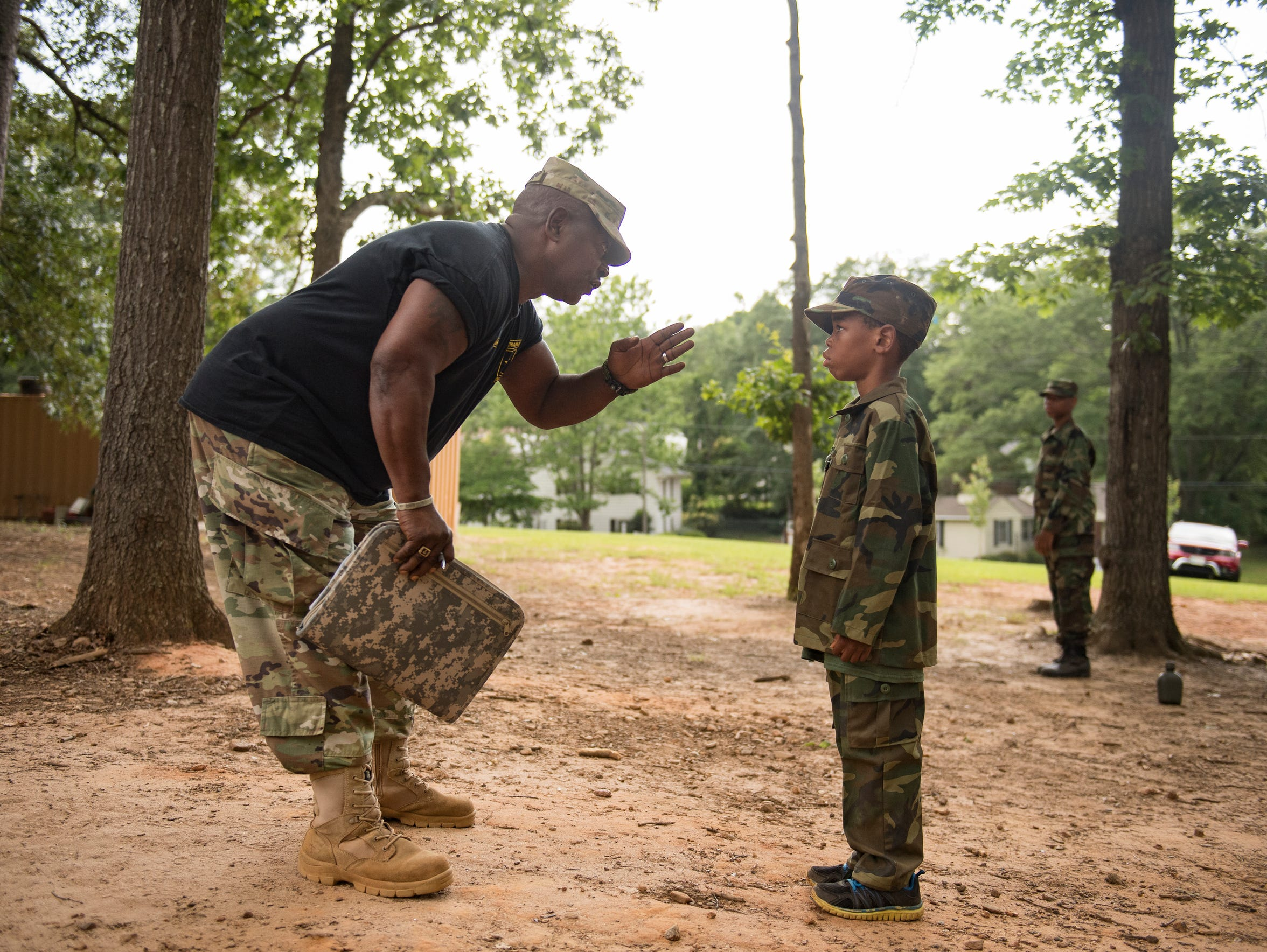 Drill Sergeant Steven Sullivan corrects Marcus Kennedy,