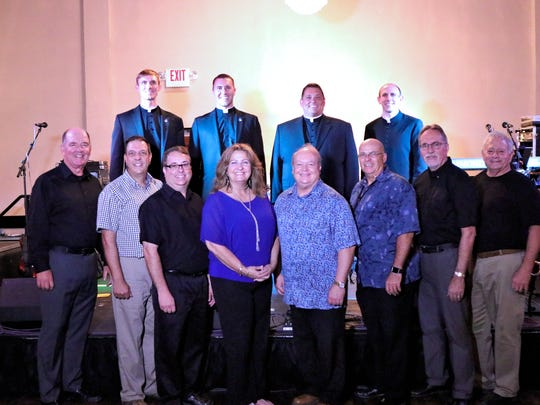 Members of the Nik-L Beer Band and newly-ordained priests
