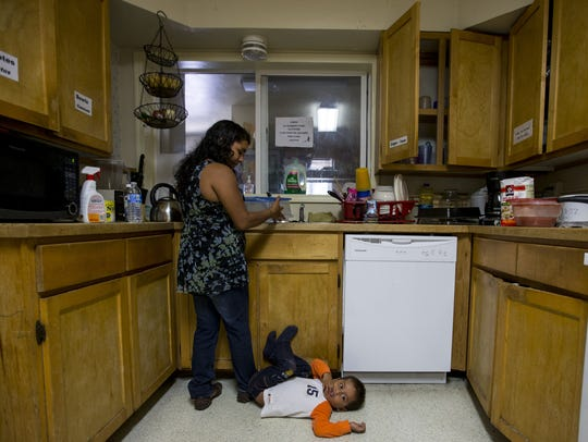 Juana Mari Lopez Juarez, of Guatemala, cleans dishes