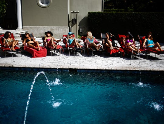 """""""Paradise Coast Wives"""" cast members lounge by the pool"""