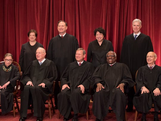 All nine Supreme Court Justices pose in 2017 for a group photo in the Supreme Court Building.