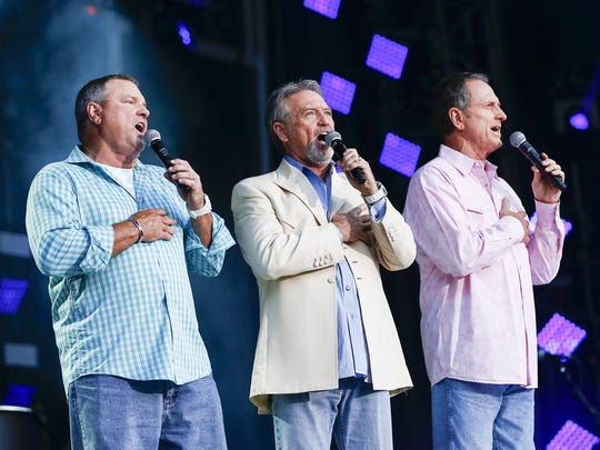 From left, Steve Gatlin, Larry Gatlin and Rudy Gatlin of the Gatlin Brothers perform the national anthem at LP Field during the CMA Music Festival on Thursday, June 11, 2015, in Nashville.