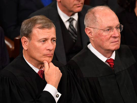 Chief Justice John Roberts with Associate Justice Anthony Kennedy in 2017, listening to President Trump's maiden speech to Congress.