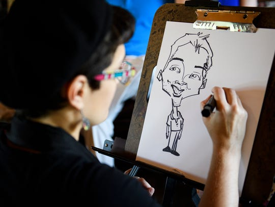 Chaterine Hosack draws caricatures at the Cliffs on