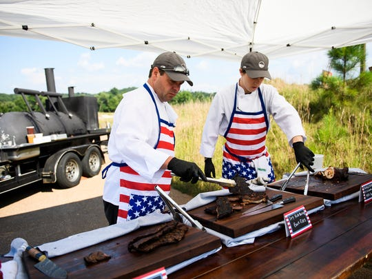 David McLeod and John West prepare ribs at the Cliffs on Tuesday on, July 3, 2018.