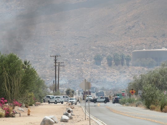 A fire burns near South Palm Canyon and Acanto drives