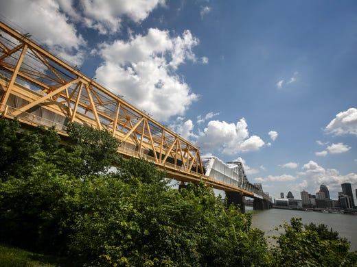 clark memorial bridge getting coat of yellow paint